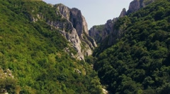 Stunning aerial view of mountainous region with cliffs and trees Stock Footage