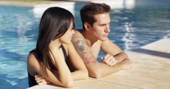 Diverse good looking couple stand in swimming pool Stock Footage