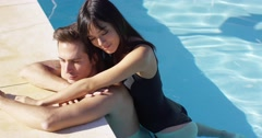 Woman in black swim suit hugs her boyfriend Stock Footage