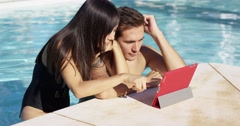Handsome couple with portable digital device Stock Footage