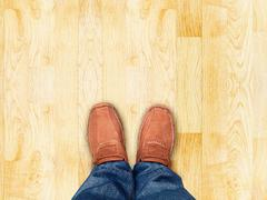 Top view,Foot stand on wood parquet sand stone ,Leave space for your content Stock Photos