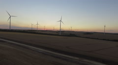 Fields and windmills at sunset. 4K aerial Stock Footage