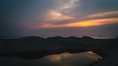 Land reclamation timelapse beside sea in sunset til night Melacca Stock Footage
