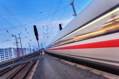 High speed passenger train on railroad track in motion Kuvituskuvat
