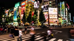Tokyo - Night street view with people on crosswalk at colorful Akihabara. 4K Stock Footage