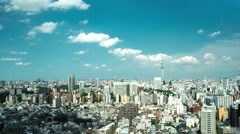 Tokyo - Aerial view of city with Skytree and clouds on blue sky. 4K time lapse Stock Footage