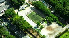 Tokyo - Aerial view of people playing football. 4K resolution time lapse. Stock Footage