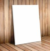 White poster frame in wooden room,mock up for your content Stock Photos