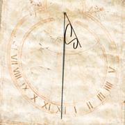 Sundial with roman numeral indicating twelve Stock Photos