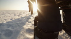 ACTION CAM: Father is sledding his son on a snow field in the winter Stock Footage