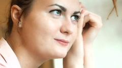 Portrait of Attractive Young Women With Green Eyes Looking at the Window. Day Stock Footage