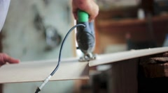 Sawing sawing a sheet of fiberboard Stock Footage