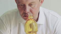 Man smelling, olive, sunflower oil Stock Footage