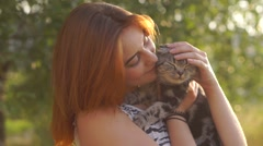Young pretty girl with scottish-fold cat outside Stock Footage