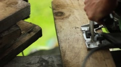 A saw sawing a Board Stock Footage