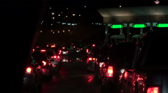 Cars at night waiting to cross boarder patrol crossing 4k Stock Footage
