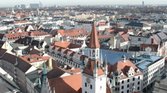 Aerial view of Munich with its Alte Rathaus (old town hall) and church Stock Footage