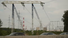 Urban landscape on the outskirts of Moscow. Power lines and cooling towers. Stock Footage