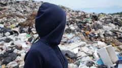 Young Woman in Mask Against Garbage in Landfill Site Stock Footage
