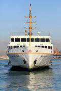 BEYOGLU Ferry sails in to Asian side Stock Photos