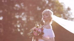 Bride in a morning golden sunlight Stock Footage