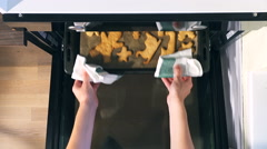 Top view of Baking Gingerbread man in the oven, view from above of the oven. Stock Footage