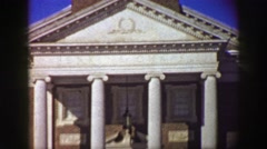 1969: Courthouse capital building college campus winter snow people walking. Stock Footage