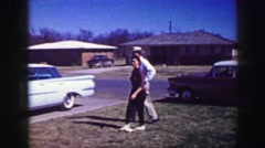 1969: Cowboy hat wearing old man family arrival Easter classic powder blue car. Stock Footage