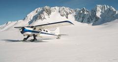 Alaskan Ski Plane Landing On Glacier Closer Approach Alaska Scenic Stock Footage