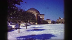 1969: College campus building winter snow covered school classroom structures. Stock Footage