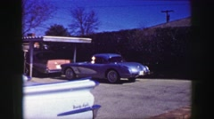 1969: Man exiting Corvette Stingray car basketball son perfect ideal life.   Stock Footage