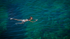 Young woman swimming in beautiful azure sea Stock Footage