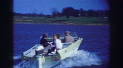 1969: Watercraft lake boating ride deep blue waters summer sunshine day. AMES, Stock Footage