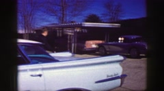 1969: Man entering Corvette Stingray car to check it out leaves shyly impressed. Stock Footage
