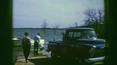 1969: Boat launch truck boat trailer loading ship after successful voyage. AMES, Stock Footage