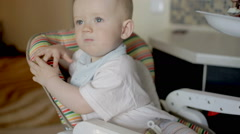 Mother feeding baby boy at home Stock Footage