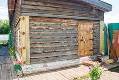 Wooden house on a garden site Stock Photos
