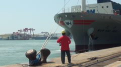 Workers are tying a container ship. Mooring operation in Kaohsiung Port Stock Footage