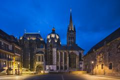 The famous cathedral of Aachen, Germany with night blue sky seen from the Kat Stock Photos