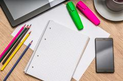 Workplace with blank white notepad, mobile phone, paper, pencils, tablet and  Stock Photos