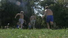 Group Of Kids Kicking And Running For The Football Or Soccer Ball In Slow Motion Stock Footage