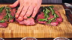 Fresh raw beef meat. Men seasons meat with oil, herbs and spice Stock Footage