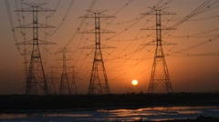 Sunrise with High Voltage Power Cables. Stock Footage