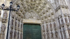 SEVILLA -  Entrance door in Cathedral Stock Footage