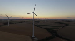 Wind Turbines at sunrise in field. New working day is starting. Aerial view 4K Stock Footage