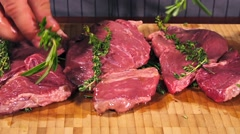 Fresh and raw veal meat. Steaks with seasonings in a row ready to cook. Stock Footage