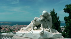 Statue of Jesus Christ and Saint Veronique with Marseille city on background Stock Footage