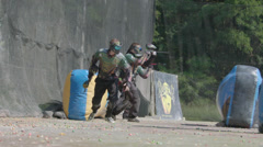 Paintballplayers start to Play in Slow Motion Stock Footage