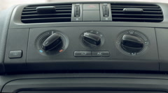 Male hand turning switch of car air conditioner Arkistovideo