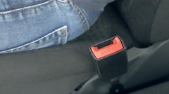 Male hand fastening car safety seat belt Stock Footage